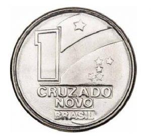 Braile na moeda de 1 Cruzado Novo que não chegou a ser lançado mas que tem a mesma configuração das peças futuras de 5, 10 e 50 cruzeiros. Além o sinal do número em si, há, à esquerda deste, o prefixo numérico (o L invertido).